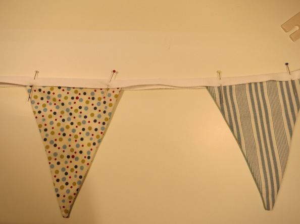 Pin bunting flags to twill tape
